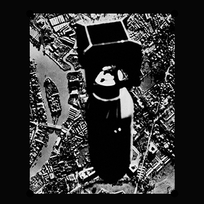 The album-cover to Fedrelandslaget - FL KO MILITS -A black and white photo of a bomb dropped over a city, framed in black